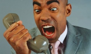 black-man-yelling-into-phone